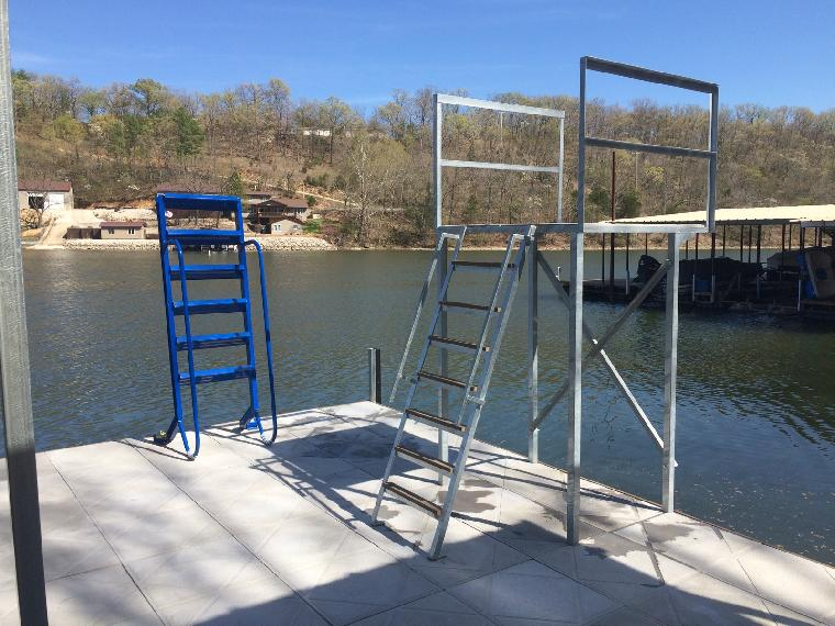 Dave's new dock install. Items installed...Dive tower and a powder coated blue wet step swim ladder.