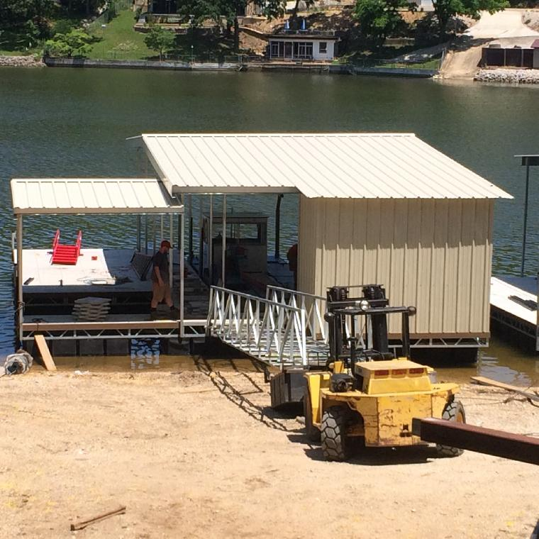 Mike's dock ready for delivery. One well dock with locker, and double PWC well. Located at the 22 mm, Osage.