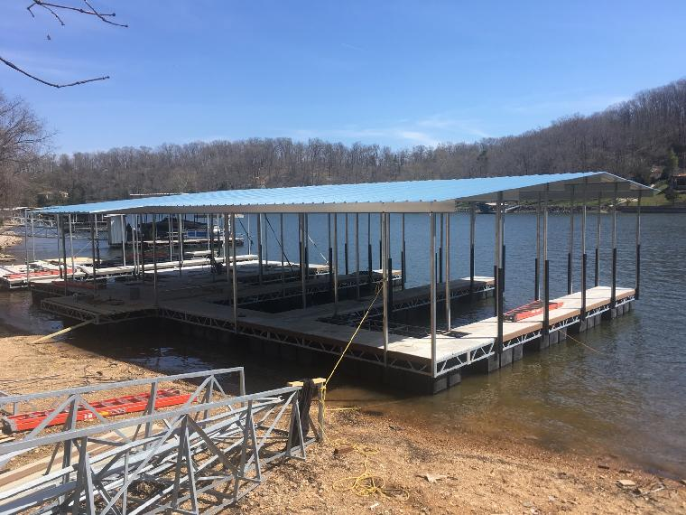 Jeffs dock. Under construction on the Gravois arm. 3 well dock, PWC slip and Bar with locker.