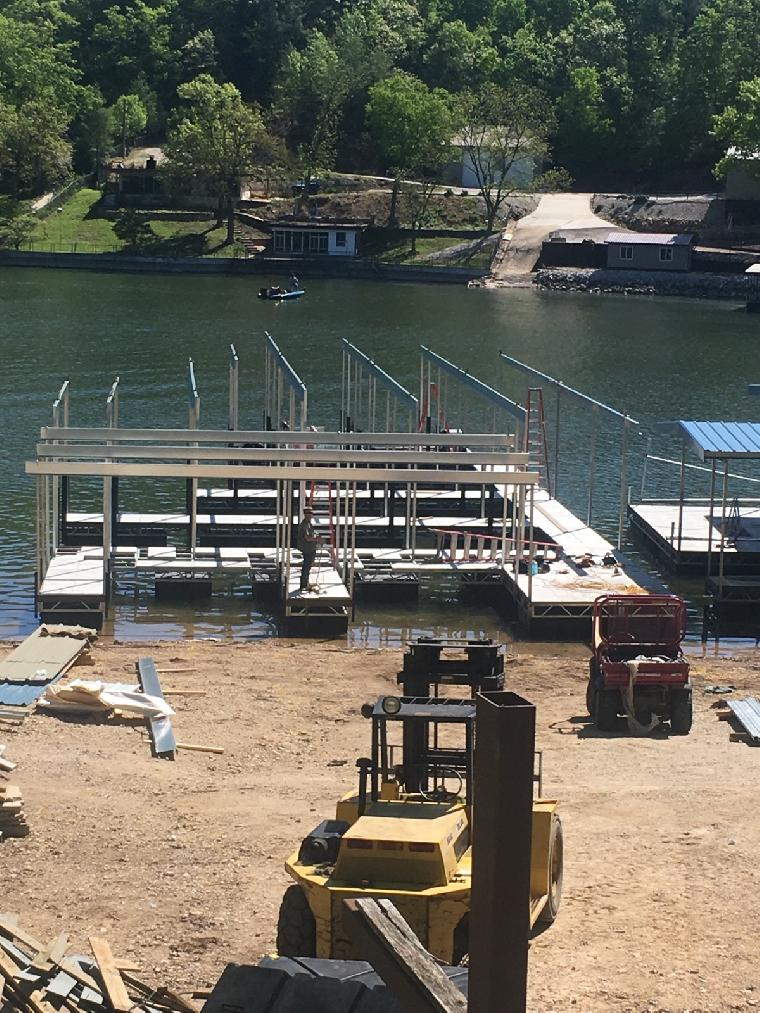 Ricks dock is underway. Includes 4 dock wells with double PWC slips.