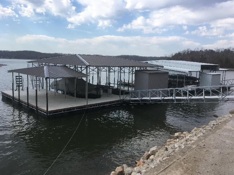 Betsy's dock is ready for summer. Beautiful 2 well dock, with a hip roof and dock storage shed / locker. Located on the 26 mile marker of the Osage.