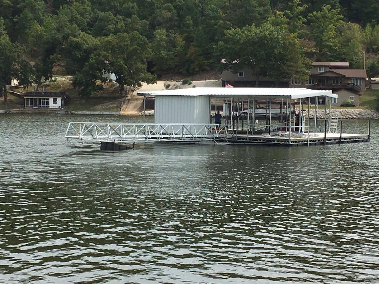 Ralph's dock heading out for delivery. 2 well dock, with PWC slip and locker. Located on the 37 mm of the Osage.
