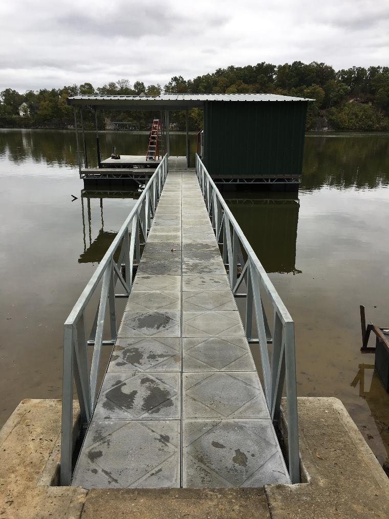 Eric's dock 60' ramp. One well dock with a PWC slip and dock locker.