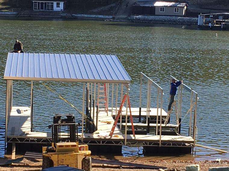 Chad's dock getting roofed. One well dock with two double PWC wells.